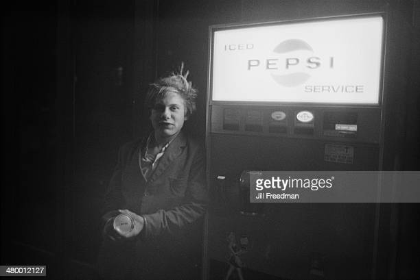 A teenager stands next to a Pepsi vending machine in London England 1969