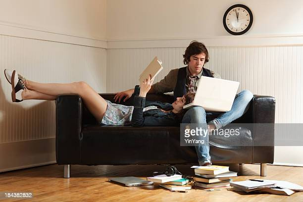 Teenager Student Couple Reading Laptop, Studying Together on Apartment Sofa