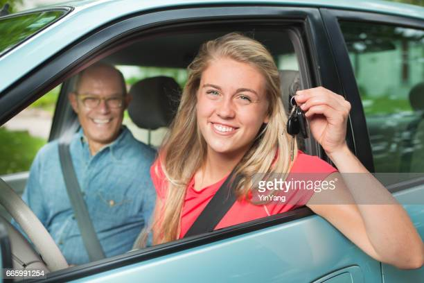 Teenager Student Driver Driving with Adult, Parent, or Father in Passenger Seat
