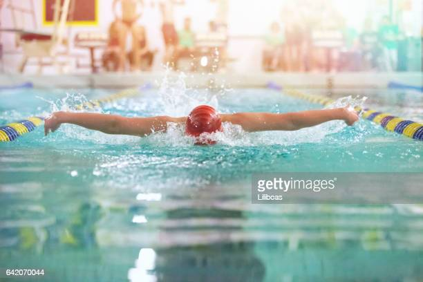 Teenager swimming butterfly