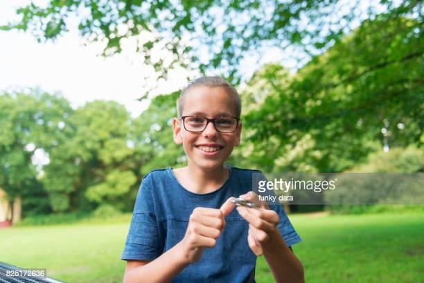 Teenager using fidget spinner