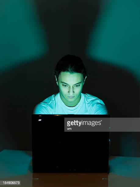 Teenager Using Laptop at Home