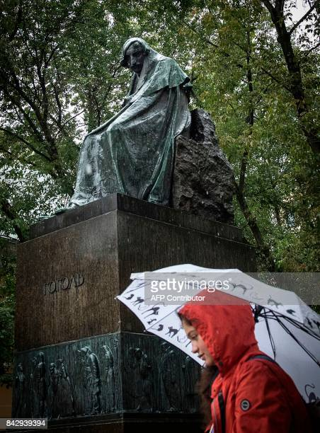 A teenager walks past a statue of Nikolai Gogol in central Moscow on September 5 2017 A new Russian film aimed at a youth audience reinvents classic...