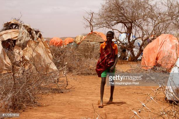 A teenager walks through Nardo Camp for the displaced in Ethiopia's Somali region Two seasons of failed rains have left millions in Ethiopia's Somali...