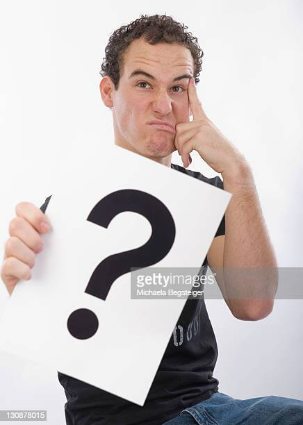 Teenager with a question mark