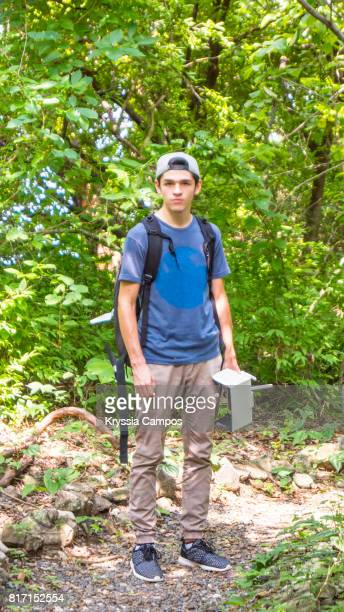 Teenager with Backpack Trekking in Rainforest