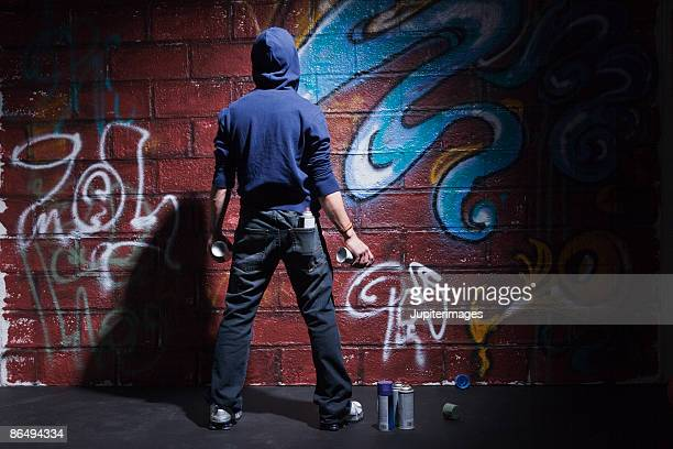 Teenager with cans of spray paint