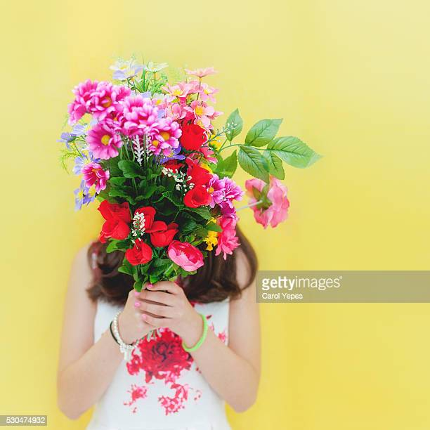 teenager with flowers in front of eyes