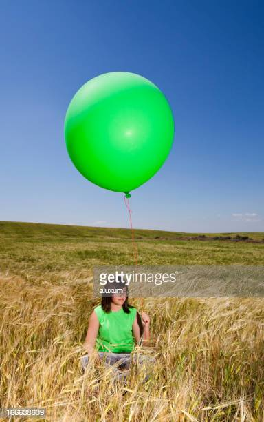 Teenager with green balloon