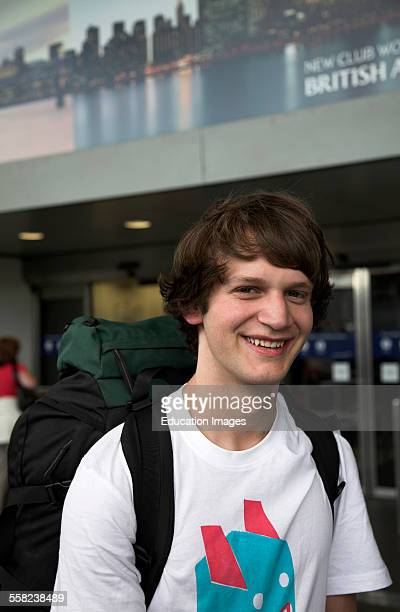 Teenager with rucksack Heathrow airport departures