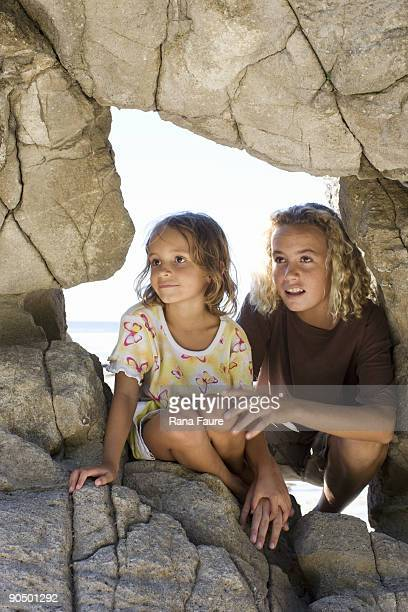 teenager with sister in rock formation