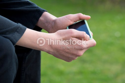 Teenager with smartphone : Stock Photo
