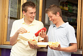 Teenagers at food stand