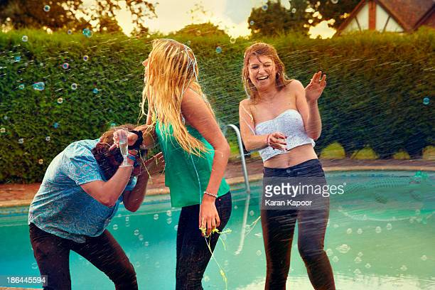 Teenagers at Pool Party being sprayed