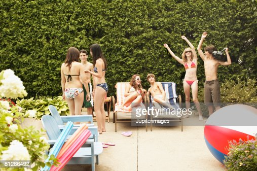 Teenagers at pool party : Stock Photo