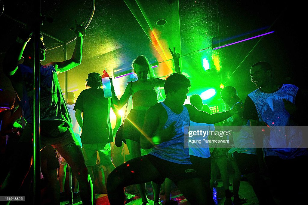 Teenagers attend a party in a nightclub during Australian 'schoolies' celebrations following the end of the year 12 exams on November 25 2013 in Kuta...