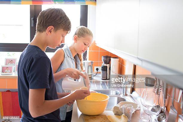 Teenagers baking a cake on August 12 in Duelmen Germany Photo by Ute Grabowsky/Photothek via Getty Images