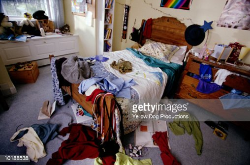 Teenager's bedroom with clothes, books and cds thrown around