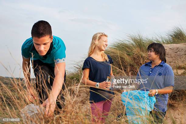 Teenagers collecting litter