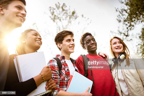 teenagers college student smiling embracing