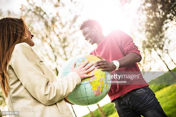 student lächelnd Teenager mit Welt