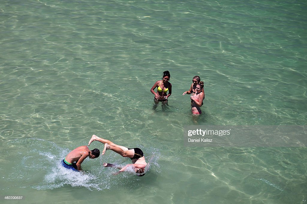 Teenagers cool off in the ocean during a heat wave at Glenelg beach on January 13, 2014 in Adelaide, Australia. Temperatures are expected to be over 40 degrees celsius all week with health authorities warning the young and elderly to remain indoors.