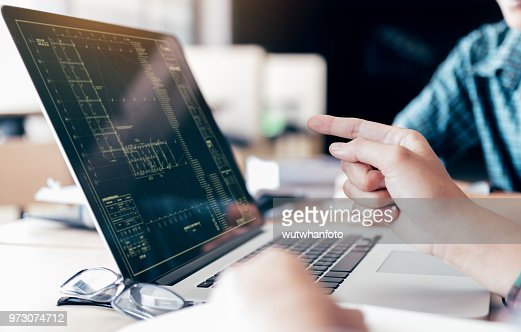 Teenagers develop programming with blueprint code in laptop monitor. : Stock Photo