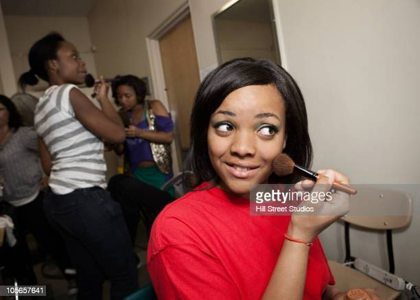 Teenagers getting ready backstage