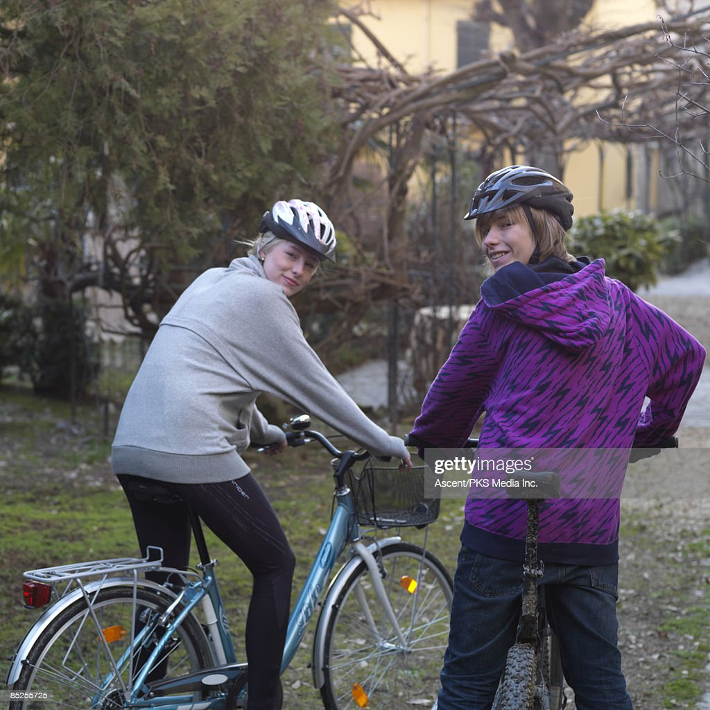Teenagers head out for a bike ride, from home : Stock Photo