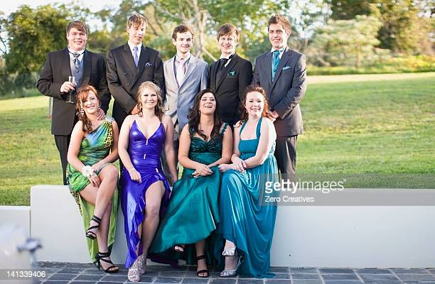 Teenagers in formal wear posing together