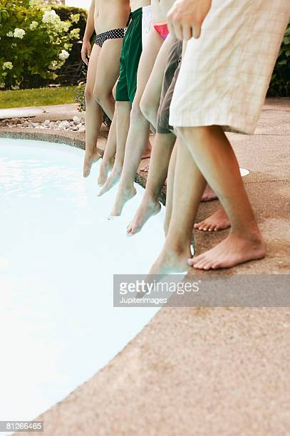 Teenagers' legs at poolside