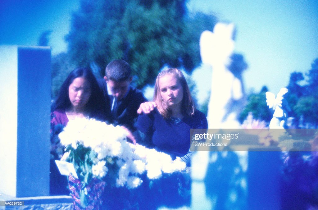 Teenagers Mourning at Funeral : Stock Photo