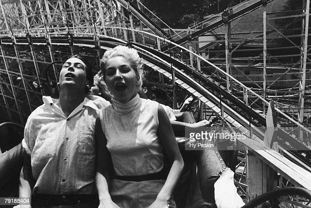 Teenagers on a rollercoaster in an amusement park 26th July 1957
