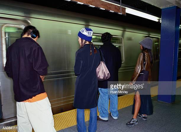 Teenagers on a Subway Platform