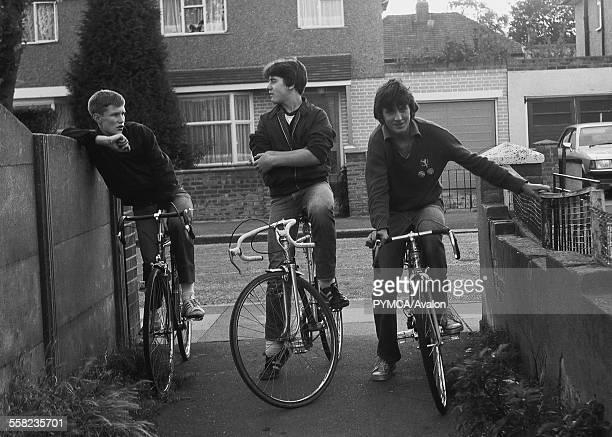 3 Teenagers on bikes in Greenford alley 1980 UK 1980