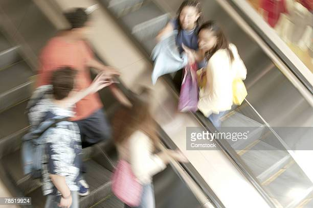 Teenagers on escalators