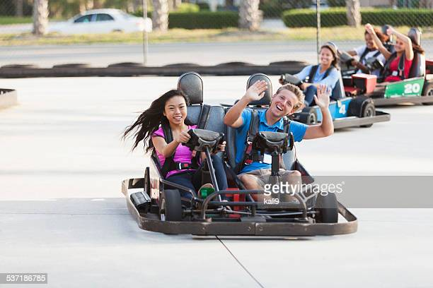 Teenagers on go carts