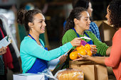 Teenagers passing out donations at food bank donation drive