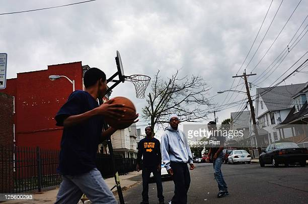 Teenagers play basketball on September 18 2011 in Bridgeport Connecticut Despite some of the poorest cities in the country Connecticut has the third...
