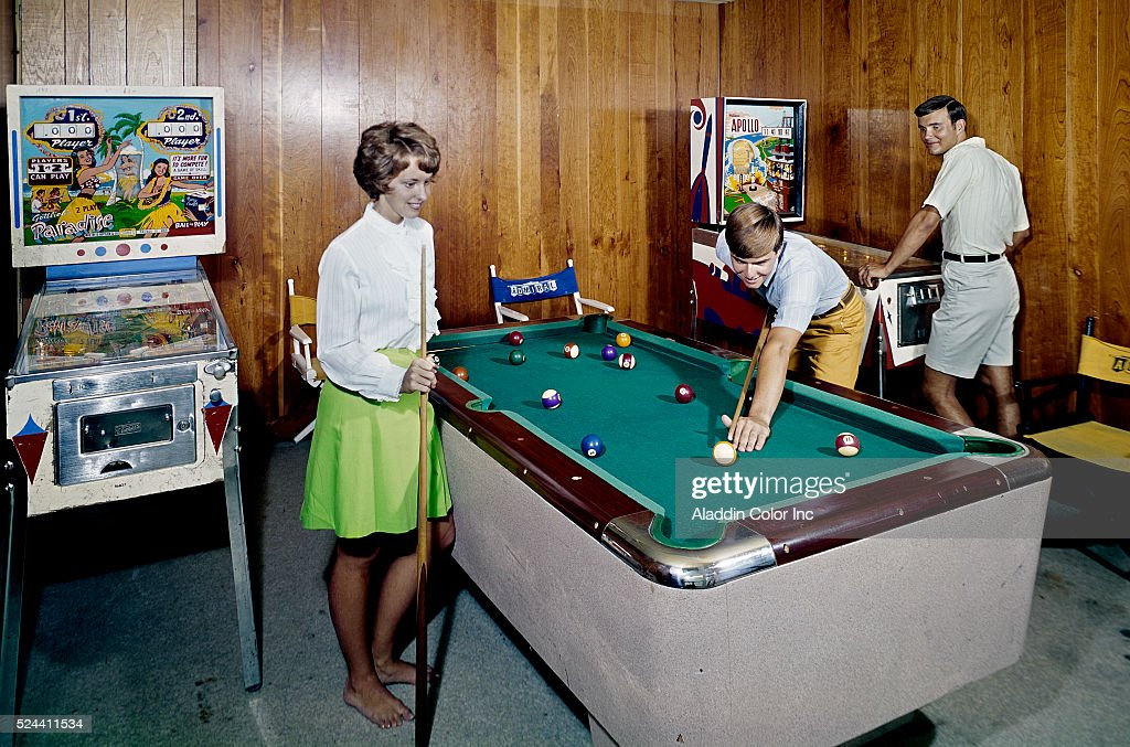 Teenagers playing pool and pinball in game room pictures for Pool game show