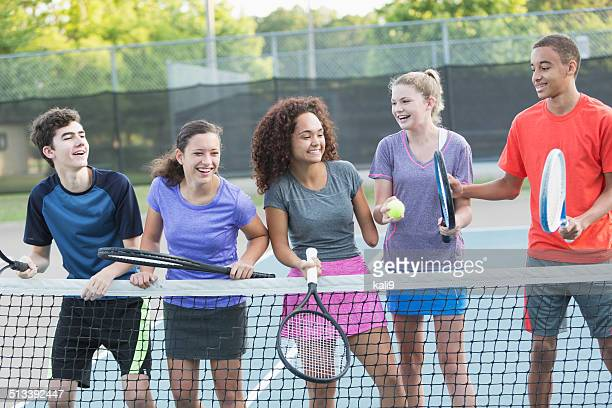 Teenagers playing tennis