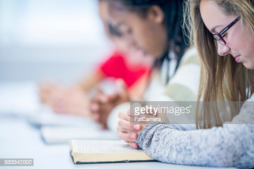 Teenagers Praying Together : Stock Photo