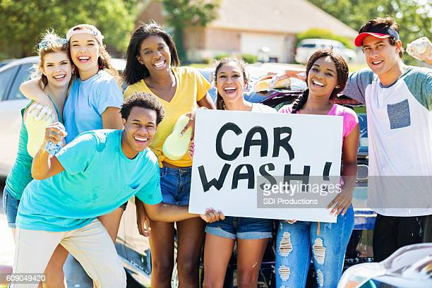 Teenagers promote car wash