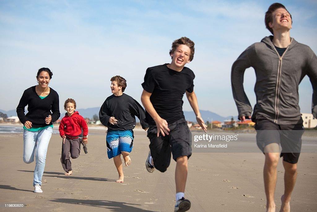 Teenagers racing on beach
