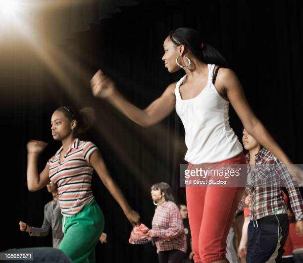 Teenagers rehearsing on stage