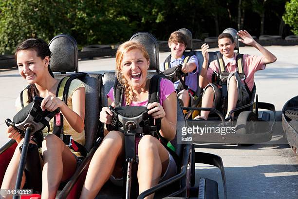 Teenagers riding go-carts