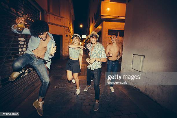 Teenagers Running Down Street During Night Party