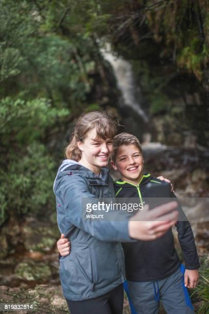 Teenagers Selfie at a waterfall