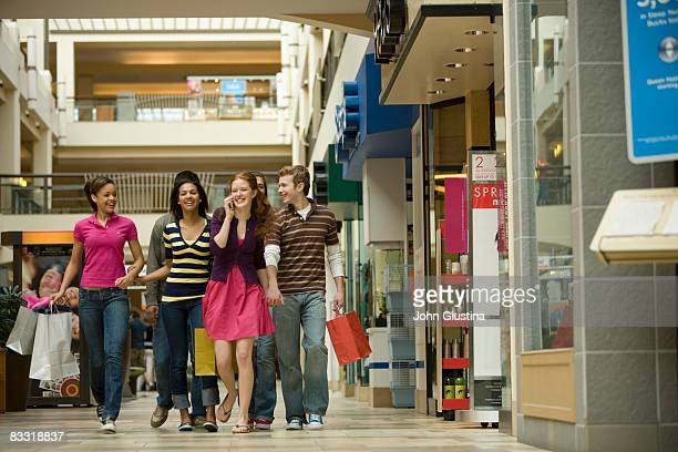 Teenagers  (14-17) shopping at the mall