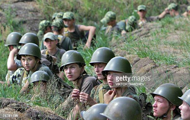 Teenagers sit in a trench during their training session 19 June 2007 in a special armysport camp for unmanageable children at Belarus military unit...